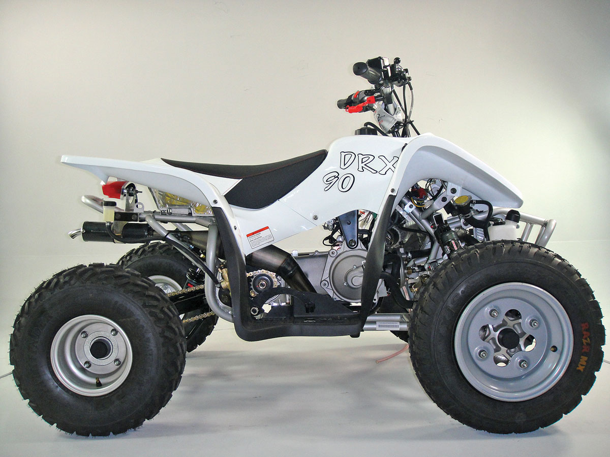 A liquid-cooled two-stroke engine gives DRR's DRX2 90 serious performance.  Double-A-arm front suspension with adjustable piggyback reservoir shocks  and ...