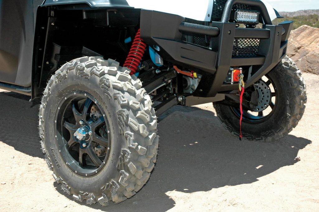 Boxed dual A-arms with spring preload- and air-pressure-adjustable shocks offer 14 inches of travel.