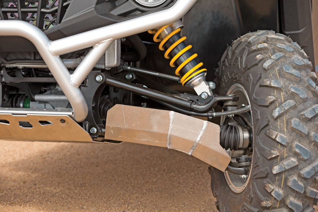 Plastic covers protect the KYB shock shafts, and bumpers soften bottoming. Non-SE owners can upgrade to these skid plates and bash plate for $499.99 and A-arm guards for $169.95, and a 27-inch MSA/EFX softterrain tire/ wheel kit is $1199.