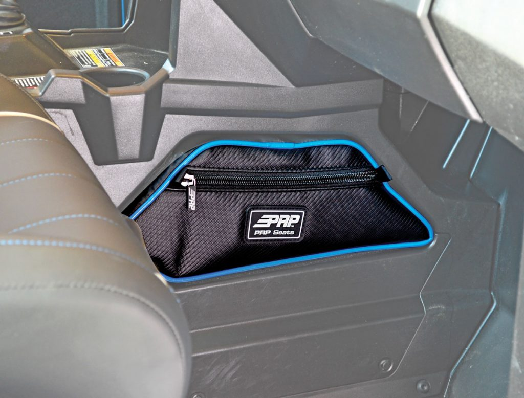 While the General's console hole looks cool, it's wasted space. PRP's console bag ($55) turns the gap into extra storage space. It's made of tough, vinylcoated nylon and marine-grade nylon with new rubberized, quiet zippers.