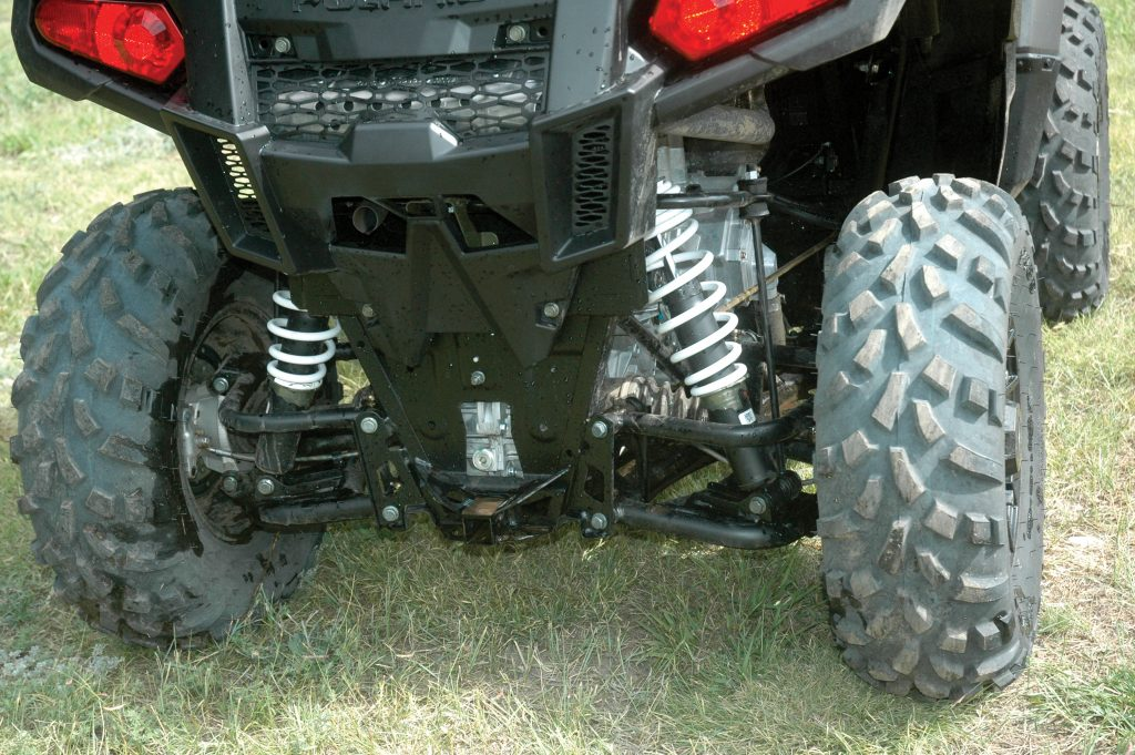 Double-A-arm rear suspension provides 9.5 inches of travel. Unlike most sport UTVs, the Ace has a trailer hitch receiver.