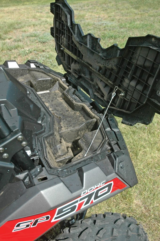 The 570 SP has a large storage compartment under the front rack.