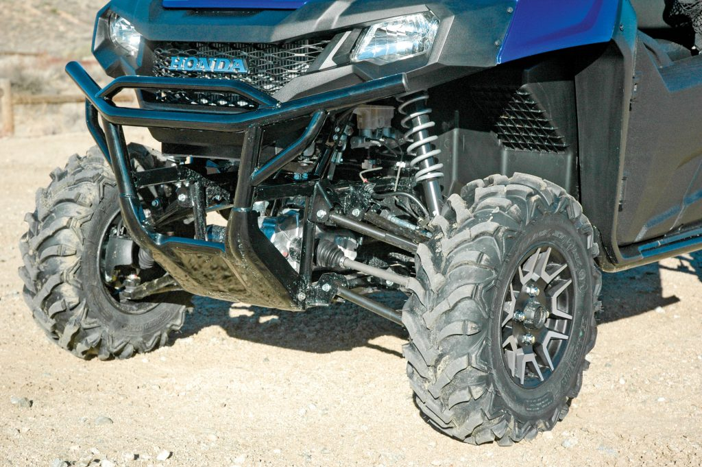 Shock springs on the 700 Deluxe's non-adjustable front shocks are silver; they're black on base and camo models. The front suspension has 7.9 inches of travel.