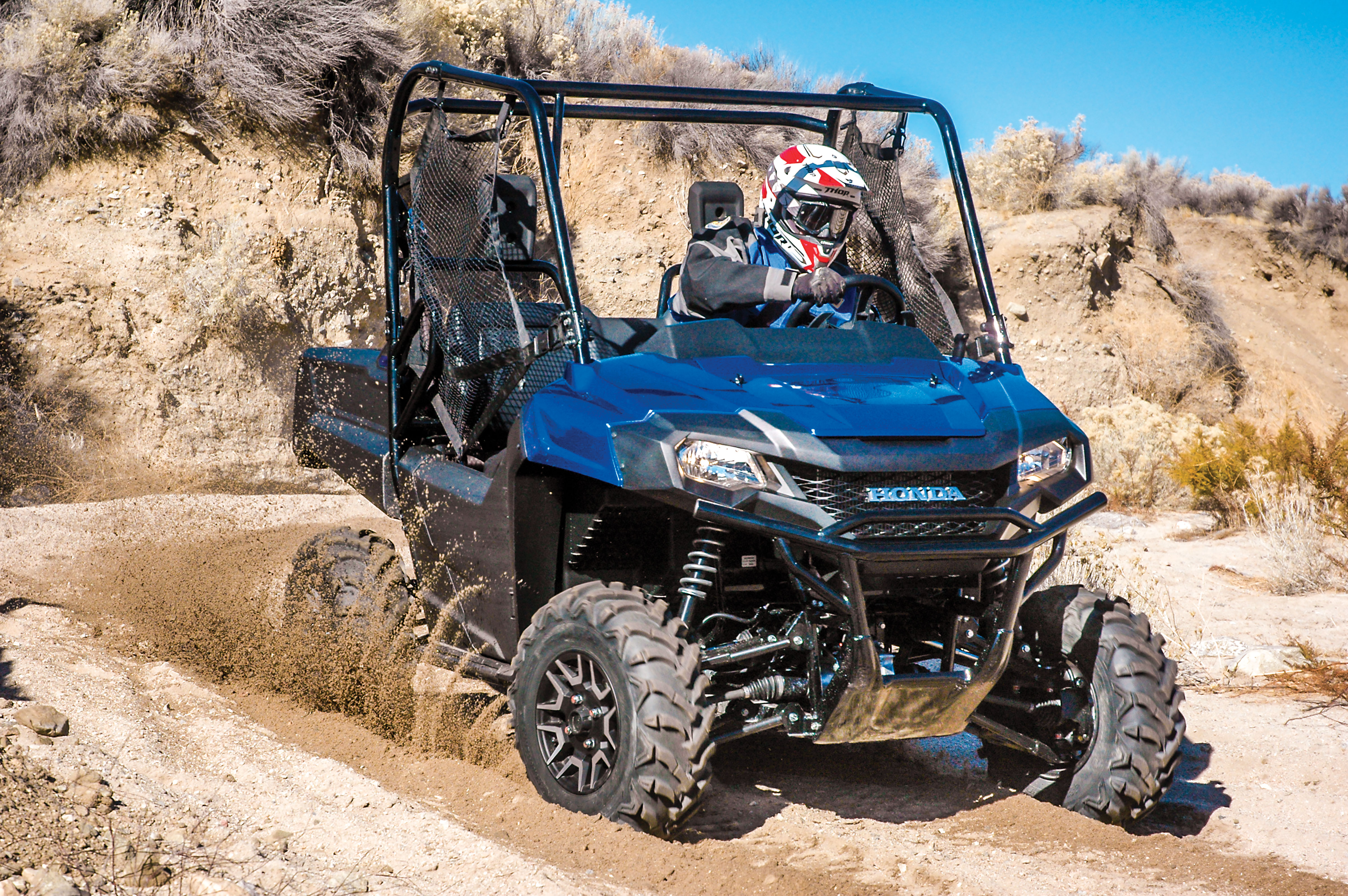 magazine utv spread deluxe action honda pioneer test
