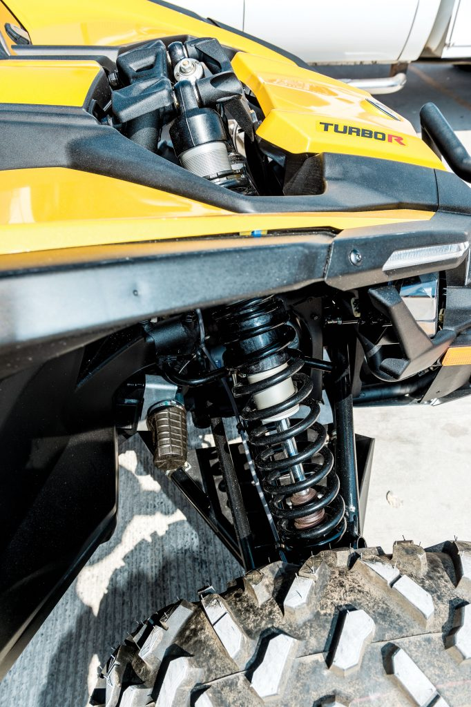 Fully adjustable piggyback reservoir Fox 2.5 RC2 front shocks poke through the hood, which is steeply angled to aid visibility.