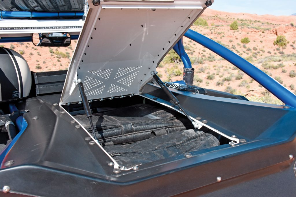 There are several ways to carry drinking and UTV water—from hydration system pouches in PRP seats to model-specific bed-sized coolers. Kory Ellis stows his Assault soft cooler ($44.95) in this trick trunk by Desertworks.