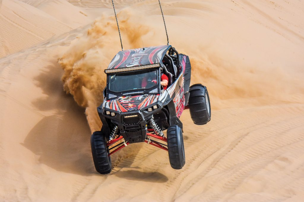 Shock Therapy's RZR XP 4 1100 is a rolling test bed for suspension and other high-performance products for duning, desert racing and playing. Check them out at Glamis' vendor row on any big weekend.