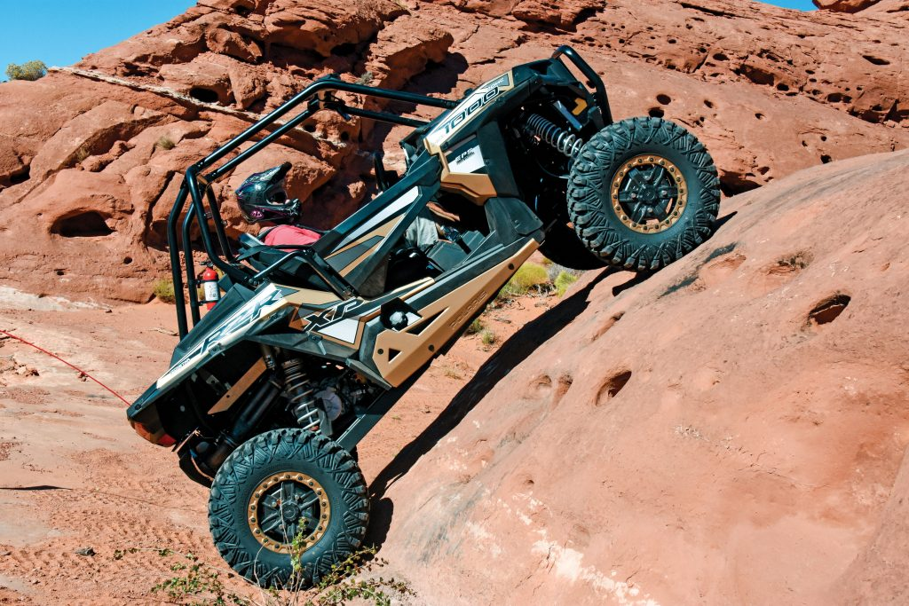 New for 2017, Polaris introduces the RZR XP 1000 Gold Matte Metallic Limited Edition, which comes fully loaded for tackling western rock monoliths and eastern limestone ledges with rock sliders, high-clearance lower suspension components, 30-inch Pro Armor tires on beadlock aluminum wheels, bull front bumper and winch.