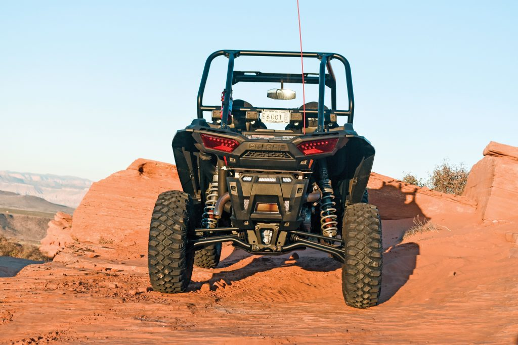 Width is still 64 inches, but the Gold Matte Metallic LE gets narrow rear 30x10-14 Pro Armor Crawler XG tires and beadlock wheels for racer-like handling in turns. High-clearance lower radius rods are mated with larger and lighter upper rods that are standard on all RZR XPs for 2017.
