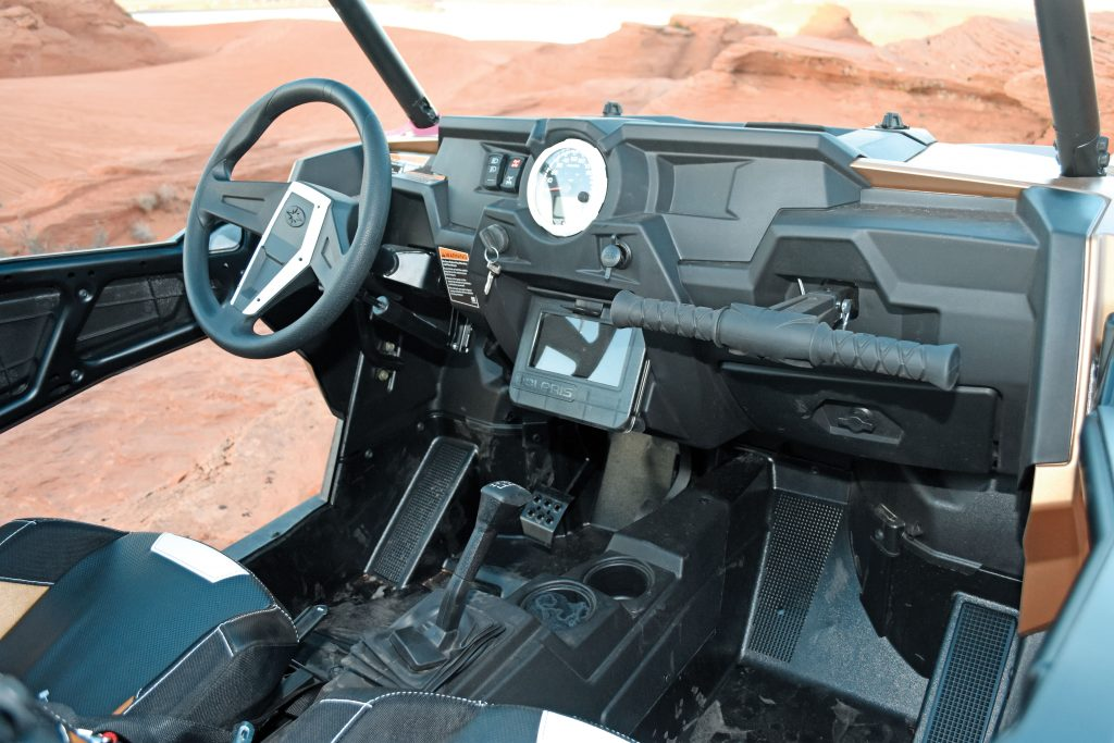 The cockpit is standard RZR XP fare with adjustable tilt wheel and passenger T-bar, but the center compartment holds the winch remote in front of the cell-phone compartment. We wish the Gold LE had the Turbo's new 1.5-turn steering rack for tight rock-crawling trails.