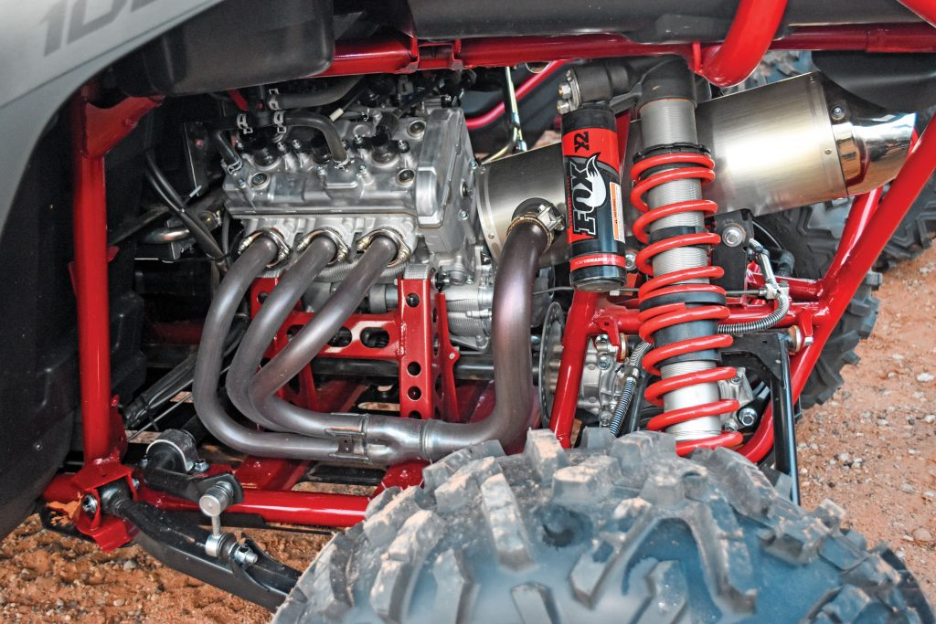 The 998cc triple with three-into-one exhaust makes 112 horsepower and sounds like a four-stroke Banshee. With 11.3:1 compression, the five-speed YXZ wants high-octane pump fuel. The rear drive shaft has a disc parking brake controlled by a lever on the console. With so much engine braking, don't bother e-braking into turns.