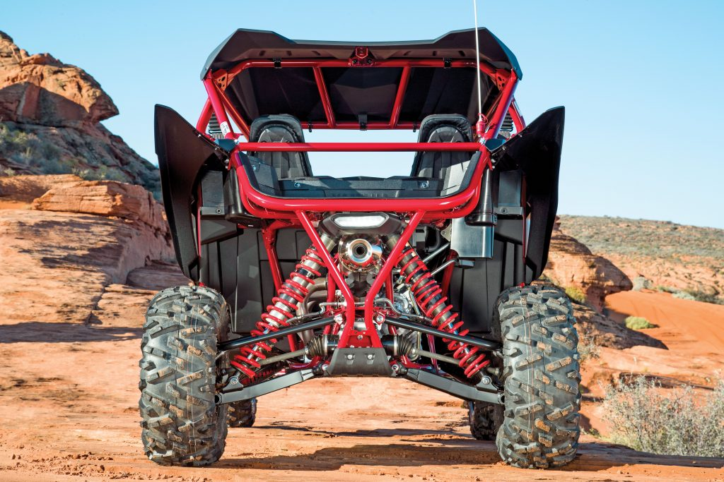 Rear travel is 17 inches, and the new Fox 2.5 Podium X2 shocks have an adjustment range for ride quality that would require re-valving on any other OEM shock. Full-length plastic skid plates protect the frame, and aluminum rear knuckles offset weight of the X2 shocks.