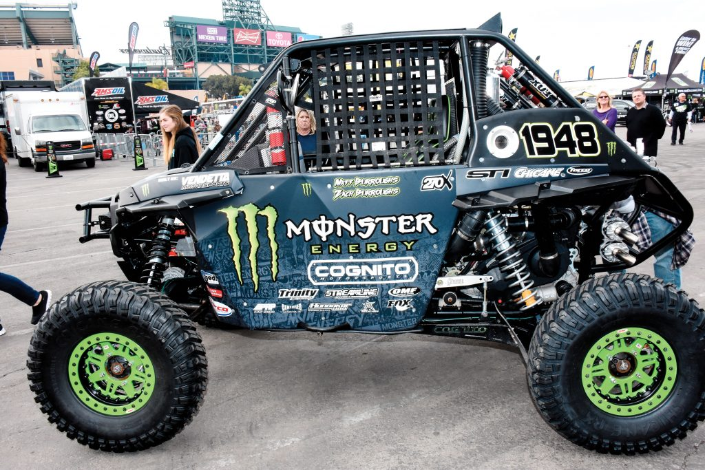 """Monster Energy RZR: Monster has the largest setup in the SX Fun Zone, complete with a sound stage and VIP area. Matt """"Monster"""" Borroughs displayed his BITD RZR XP1K in which he finished the 2016 series in fourth, with several podiums at 2016 SX rounds. He's in a Cognito Maverick X3 this year."""