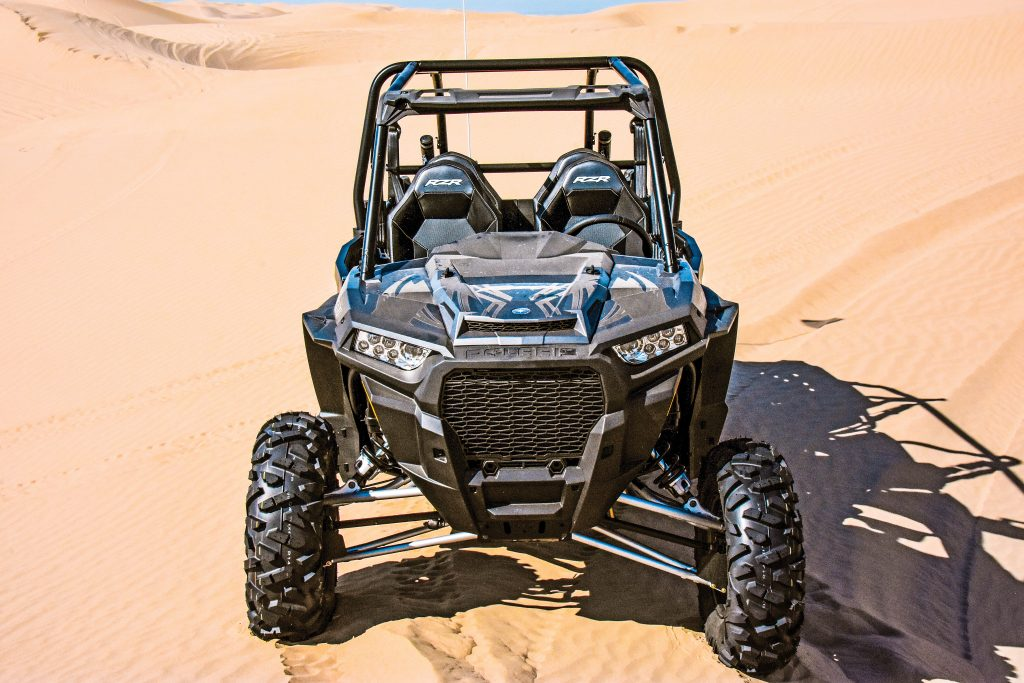 The new front fascia has a 40-percent-larger grill to feed fresh air to the new engine and Turbo radiators and a variable-speed, brushless fan. Front travel is 16 inches, and front A-arms are linked by a torsion bar.
