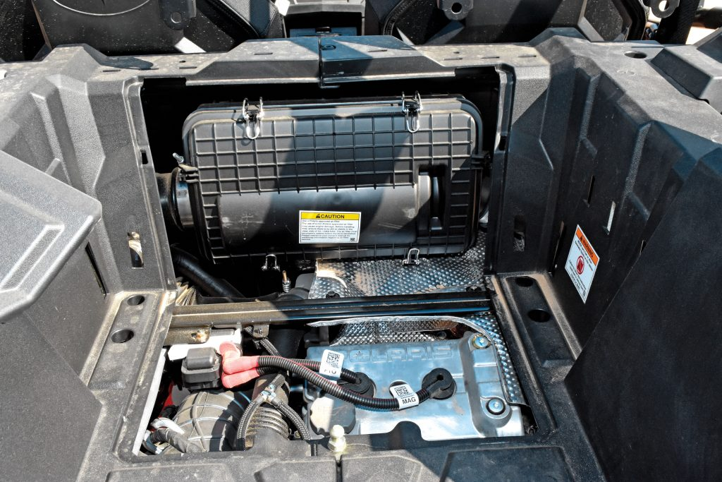 Pop the bed-access panel to change the paper-pleat air filter, add engine oil or change the spark plugs. Bed capacity is 300 pounds, and the Polaris has two PURE Lock & Ride cooler boxes (48 and 51 quarts, $349.99), a Lock & Ride cargo box (65 liters, $249.99) and a cargo box by Ogio (100 liter, $299.99) for the XP/XP 4.