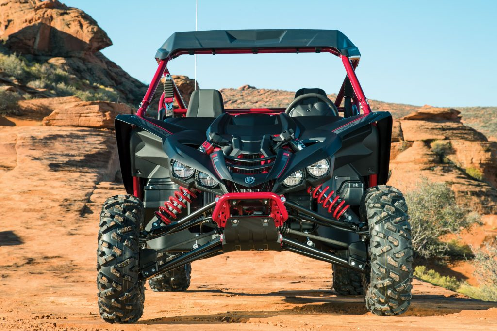 Front travel is 16.2 inches, and the aggressive styling and quad headlights make the YXZ look mean. Despite having a lower seating position than a RZR, the YXZ's hood is sloped to provide a better trail view for picking lines. Even the base YXZ1000RR and Sport Shift versions have a sun top.