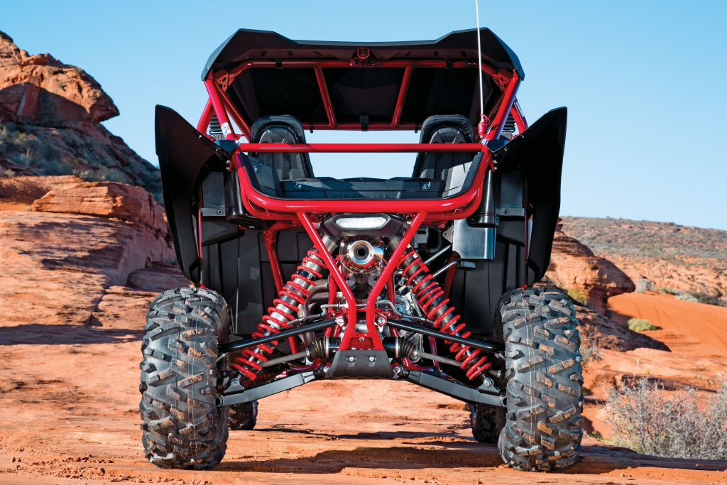 Rear travel is 17 inches, and L-shaped lower suspension arms are linked by a heavy-duty torsion bar. You don't have to remove body panels to install a dune safety whip, unlike with the RZR XP and Maverick 1000R. Ground clearance is 12.9 inches.
