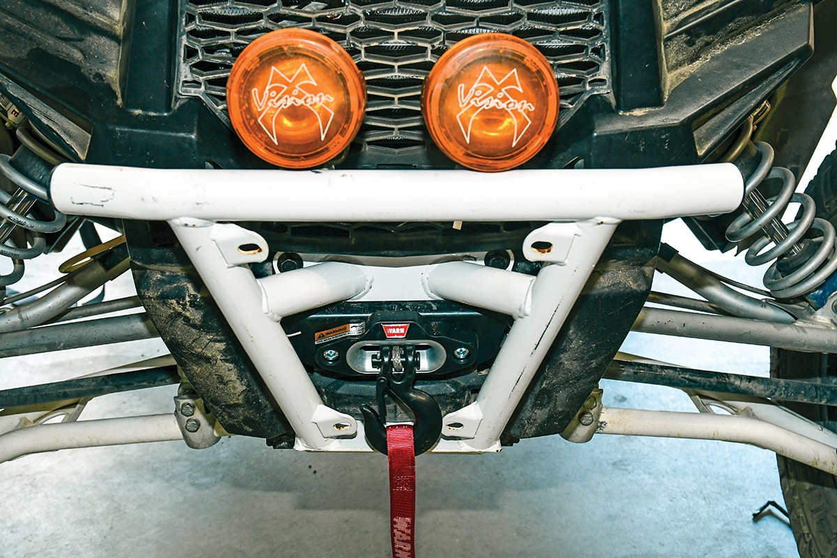 INSTALL A WARN WINCH IN A RZR XP 1000 | UTV Action Magazine